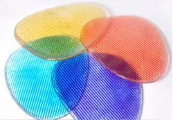 Posavasos en color aguamarina, azul, rojo y amarillo